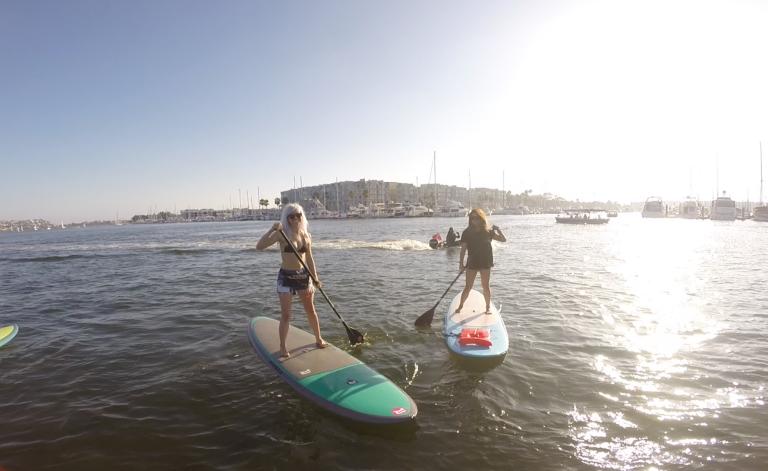 Holly and Vivian paddleboarding