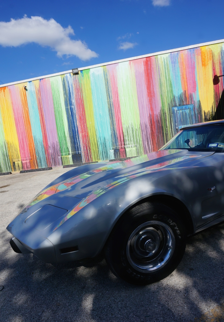 1978 corvette in front of Biscuit paint wall
